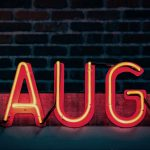 neon sign; laugh
